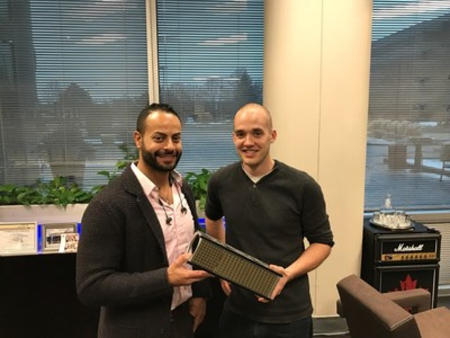 Two of Kepler Communications founders, Samer Bishay, left, and Jeffrey Osborne, hold one of the nano-satellites to be launched later this year. (CNW Group/Kepler Communications)