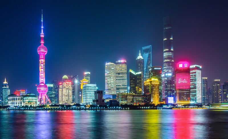Night scene of Barbie by lighting up Shanghai 's Oriental Pearl Tower and Aurola