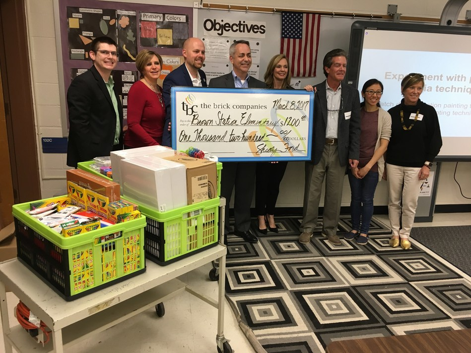 SpringHill Suites Gaithersburg and The Brick Companies raised funds for local elementary school art supplies. Pictured: Wade Stonesifer, Hotel Operations Manager; Joan Renner, CFO, The Brick Companies; David Burge, Dual Assistant Hotel GM; Steve Osbon, Dual Hotel GM; Julie Natoli, Chief Investment and Risk Officer, The Brick Companies; Lex Birney, CEO, The Brick Companies; Nabby Cheung, Art Teacher, Brown Station Elementary School; Shelly Ford, Chief Responsibility Officer, The Brick Companies.