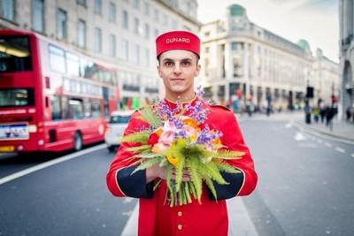 Cunard bellman showcasing Jenny Tobin bouquet in London.