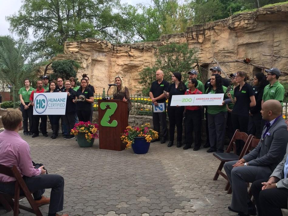 Flanked by San Antonio Zoo CEO and Executive Director Tim Morrow (right center) and zoo staff, American Humane President & CEO Dr. Robin Ganzert announces that the San Antonio Zoo has earned her organization's coveted Humane Certified(TM) seal of approval for animal welfare.