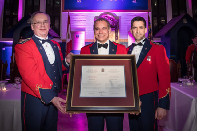 The nomination of the President and Chief Executive Officer of VIA Rail Canada, Yves Desjardins-Siciliano, as the Honorary Lieutenant-Colonel of the Régiment de Maisonneuve was officially celebrated yesterday evening. On the picture: Lieutenant-Colonel Jean-François Latreille, CD, Commanding officer of the Régiment de Maisonneuve; Yves Desjardins-Siciliano, President and CEO of VIA Rail and Honorary Lieutenant-Colonel of the Régiment de Maisonneuve; and Colonel (ret.) Roger Chouinard, CD, Honorary Colonel of the Régiment de Maisonneuve. (CNW Group/VIA Rail Canada Inc.)