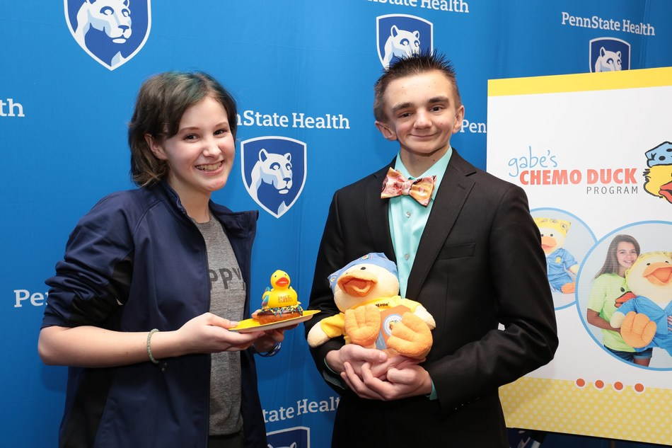 """Duck Donuts Franchising Company LLC announces its national corporate sponsorship with Gabe's Chemo Duck Program. Lily Jordan and Gabe Sipos, pediatric cancer champions, celebrate as #DuckChampionsUnite at a media conference at Penn State Children's Hospital. """"Our partnership provides Chemo Ducks to pediatric cancer patients in hospitals around the U.S., offering education, comfort, and huggable hope,"""" says Russ DiGilio, founder/CEO of Duck Donuts."""