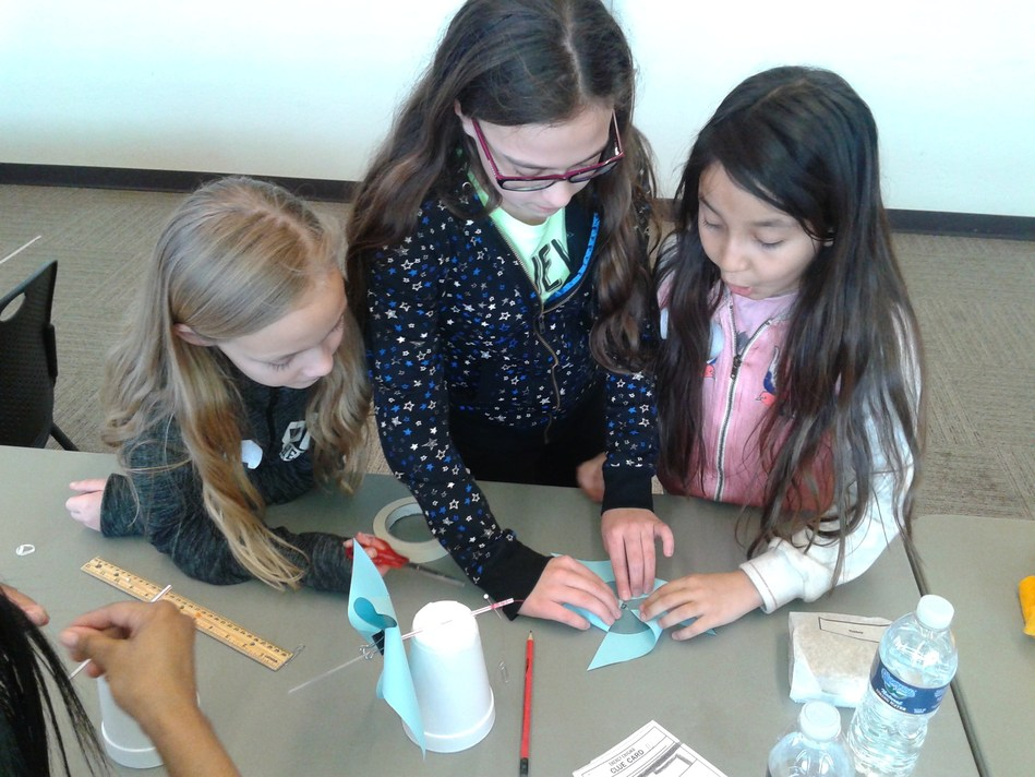 Students visit a tactile learning station at the recent CITGO Energy Workshop at the Lemont Township Community Center.