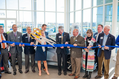 Tom Doll, President of Subaru of America, and Liza Borches, President and CEO of Carter Myers Automotive, cutting the ribbon. Photo by: ZayasImagery (ZayasImagery.com)