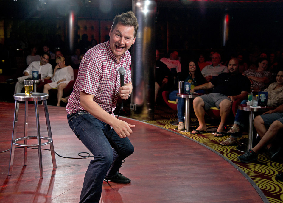 Guests can enjoy lots of laughs on cruise vacations with brands such as Carnival Cruise Line, Cunard, Holland America Line and Princess Cruises. In this photo, British comedian Phil Walker performs on Carnival Cruise Line's Carnival Vista.   Photo courtesy of Carnival Cruise Line