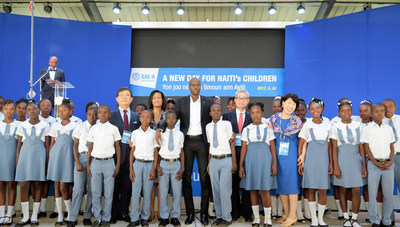 Woong-Ki Kim, Chairman of Sae-A, a leading global apparel manufacturer and Jovenel Moise, the President of Haiti are taking a commemorative photo at the ribbon-cutting ceremony of S&H Secondary School in Haiti.