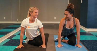Helthee trainer going through a series of stretches with her client.