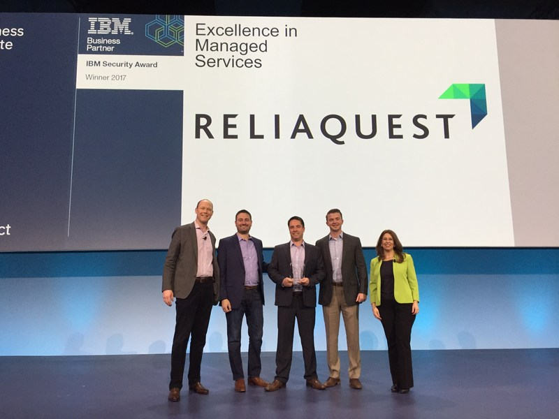 """IBM announces ReliaQuest as recipient of 2017 """"Security Excellence in Managed Services"""" award. From left: Marc van Zadelhoff, IBM Security General Manager; Chris Ellett, ReliaQuest VP of Sales; Joe Partlow, ReliaQuest Chief Technology Officer; Pat Younger, Manager of Sales Operations and Partnerships; Carol Cazenave, IBM Security VP of Sales for Business Partners and Digital Sales."""