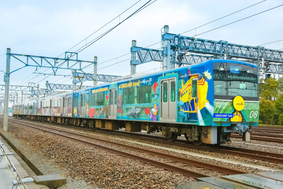 """Nicknamed """"the LEGOLAND Train,"""" a commuter train themed after attractions at LEGOLAND Japan began service on the Nagoya Rinkai Rapid Transit's Aonami Line on March 27. The train consists of four cars that are themed after the Lost Kingdom Adventure, The Dragon Coaster, Rescue Academy and Submarine Adventure attractions, so guests can begin their LEGOLAND experience before they arrive at the theme park. LEGOLAND Japan will open April 1, 2017, and is geared for families with children 2-12."""
