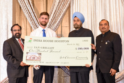 Ian Grillot (second from left) receives a check for $100,000 from India House Houston trustee Charlie Yalamanchili (left) and India House Gala Chair Jiten Agarwal (far right) in the presence of Indian Ambassador to U.S. Navtej Sarna.
