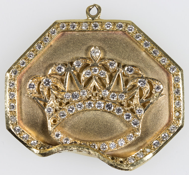"Rap artist Tupac Shakur's gold and diamond medallion obtained from a close family relation. It is believed that the indentation at bottom was caused by a bullet strike from the mortal wounding of Shakur in Las Vegas on Sep. 13, 1996. The medallion will be sold at ""The Black Heritage Auction"" in Brooklyn, N.Y. on April 7th, 2017, the same day Shakur will be inducted into the Rock & Roll Hall of Fame a few blocks away."