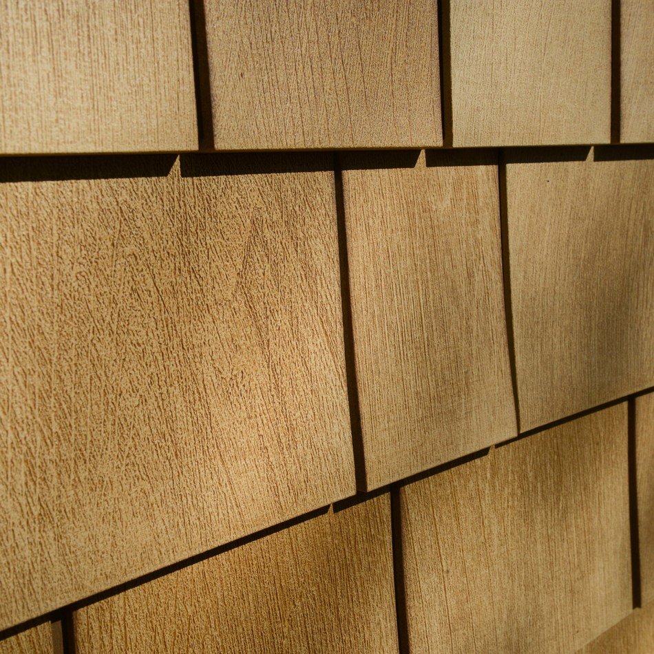 New Beach House Shake by Tando is indistinguishable from cedar shake and requires little to no upkeep.  No more painting or scraping and it stands up to harsh weather on the shoreline or inland. www.tandobp.com