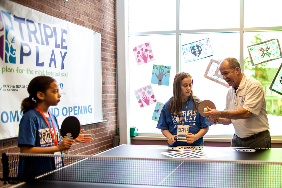 Club members engage in ping pong instructional in the newly renovated gamesroom.
