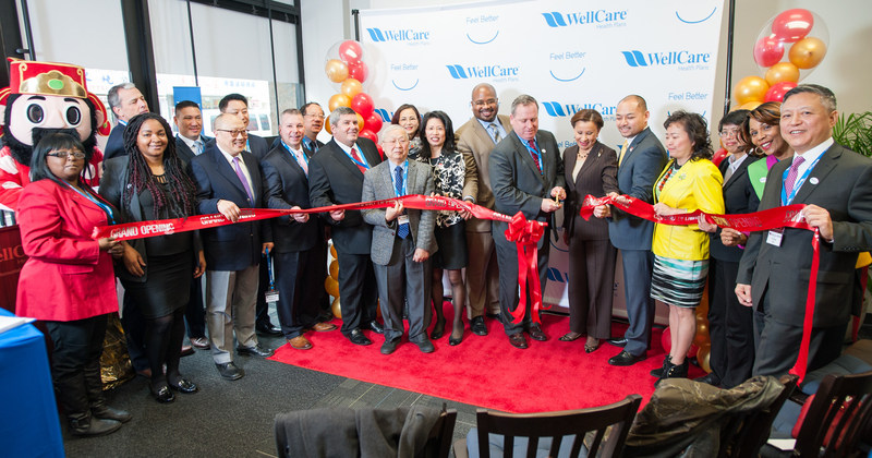 Civic and business leaders look on as John J. Burke, WellCare NY President and Congresswoman Nydia Velazquez cut the ceremonial ribbon to celebrate WellCare of New York's new community center in Chinatown.