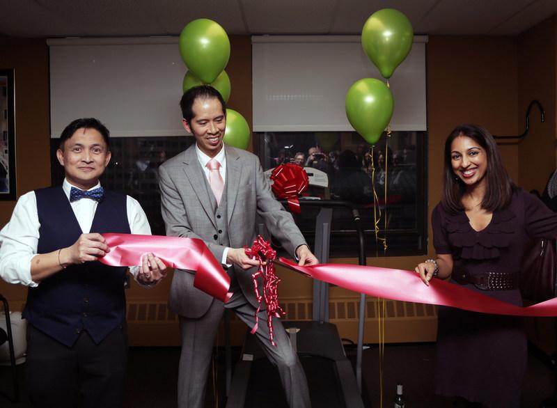 l to r: Physical Therapists Humberto Colmenares, Dr. James Pumarada, & Dr. Asha Koshy cut the 10 year ribbon
