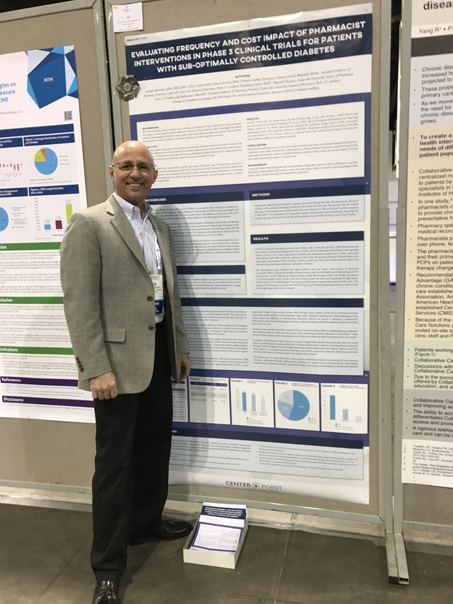Center Point Clinical Services CEO Joe Martinez celebrates winning an #AMCP17 blue ribbon for a poster he authored and presented at this year's meeting.
