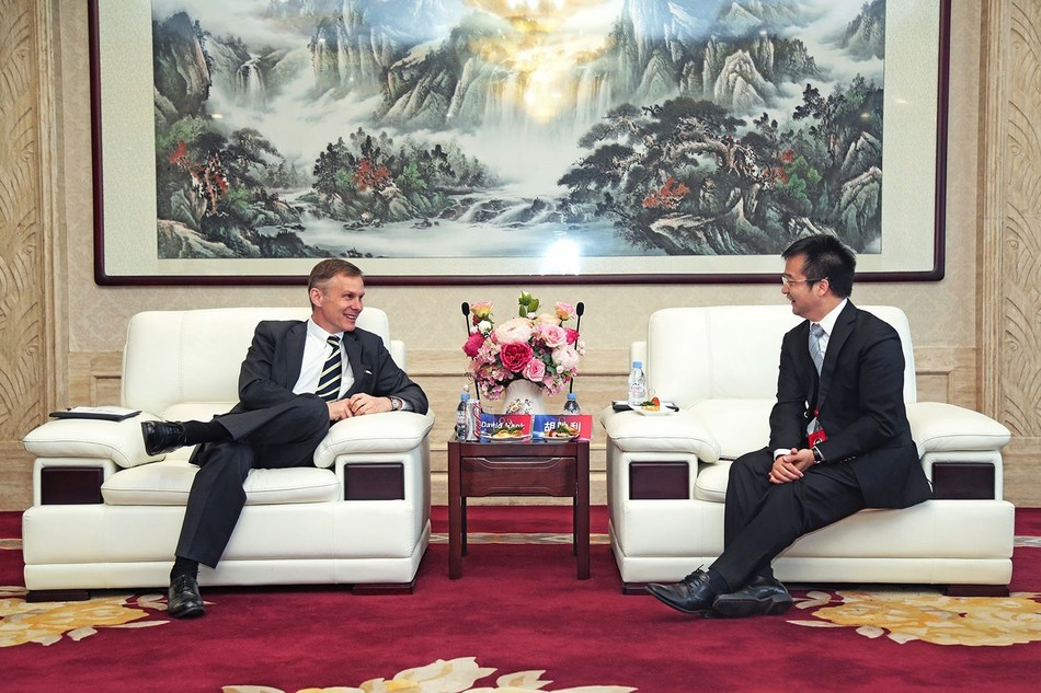 Discussion between Present Hu Shengli and the Charge d'Affaires ad interim of U.S. Embassy, Beijing, David Rank