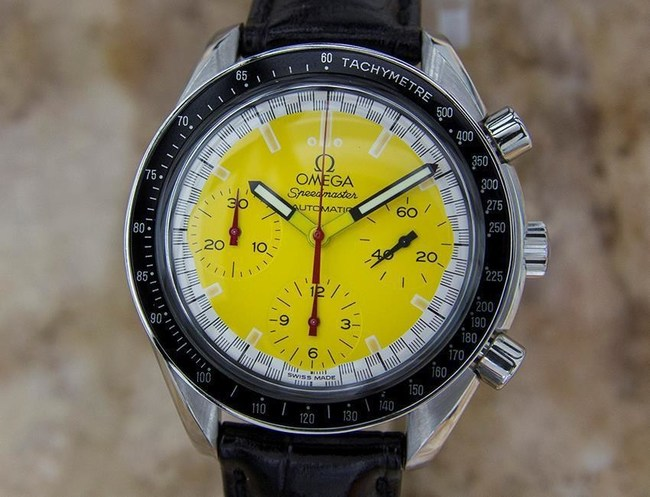1990's Omega Automatic Speedmaster Michael Schumacher 39mm Stainless Steel Chronograph Swiss Vintage Men's Watch yellow dial on leather.