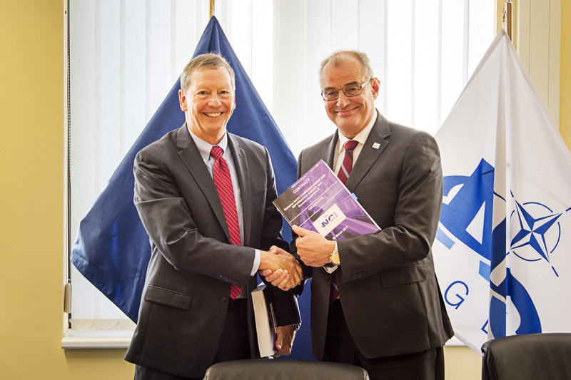 Dan Johnson, president of General Dynamics IT, and Koen Gijsbers, General Manager of the NATO Communications & Information Agency, after signing the NATO IT Modernization contract in Brussels, Belgium on March 30, 2017. The contract represents the largest modernization of NATO's IT Infrastructure in recent years and will further improve the resilience of NATO networks.