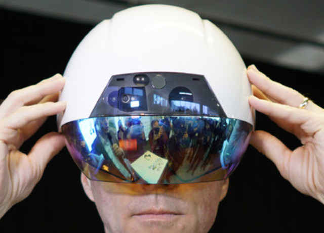 Canadian Finance Minister Bill Morneau wears Accenture's AI-enabled DAQRI Smart Helmet during the launch of the Vector Institute for AI at the MaRs Discovery District in Toronto, Ont. on Thursday, March 30, 2017.  THE CANADIAN PRESS IMAGES/J.P. Moczulski (CNW Group/Accenture)