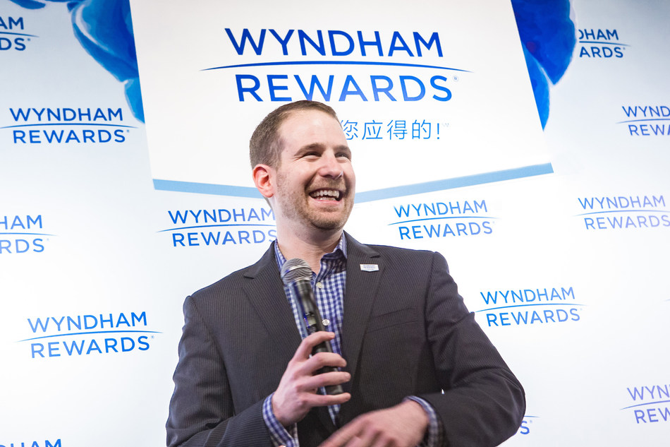 Noah Brodsky, Wyndham Hotel Group senior vice president of worldwide loyalty and engagement, addresses media at a press conference following the announcement that Wyndham Rewards, the company's award-winning loyalty program, has surpassed 50 million members.