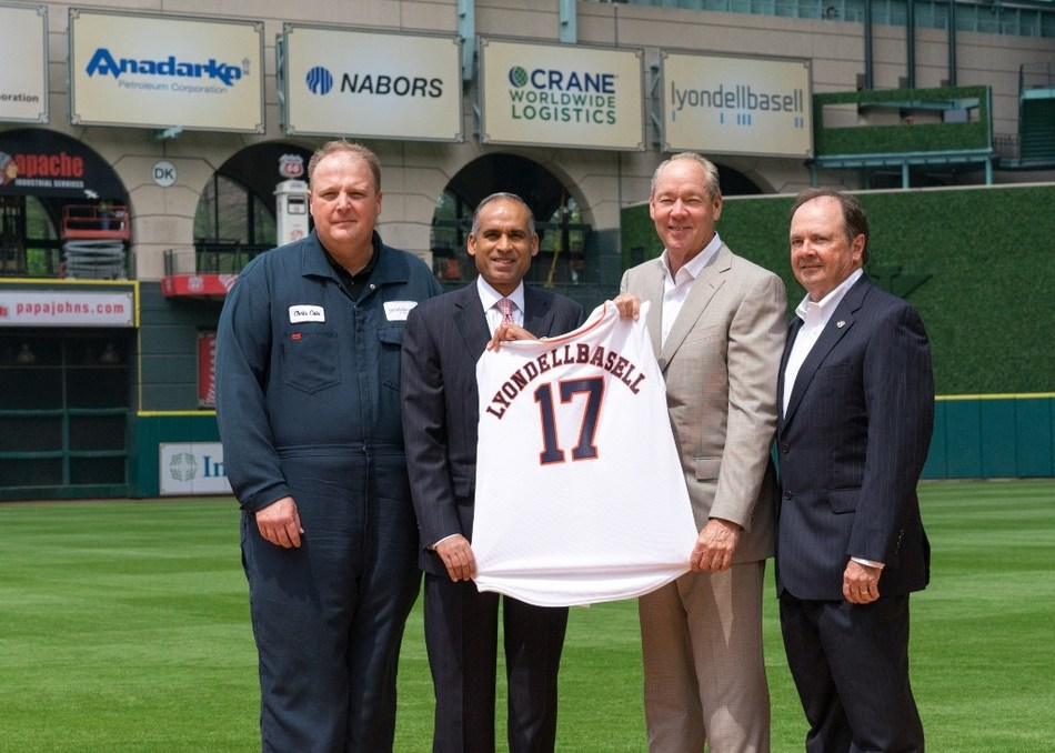Jim Crane presents Bob Patel with a 2017 LyondellBasell Astros jersey alongside Chris Cain and Louis Rigby on the field at Minute Maid Park to commemorate the company joining the Astros Foundation Community Leaders program. (L-R: LyondellBasell La Porte, Texas, Site Manager Chris Cain; LyondellBasell CEO Bob Patel; Houston Astros Owner and Chairman Jim Crane; and La Porte Mayor Louis Rigby)