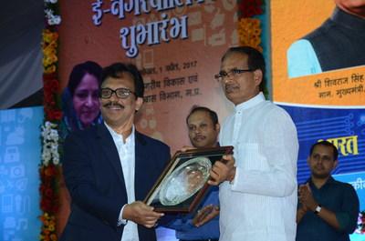 Mr. Sajan Pillai, CEO, UST Global, along with the Shri Shivraj Singh Chouhan, Honorable Chief Minister of Madhya Pradesh (PRNewsFoto/UST Global)