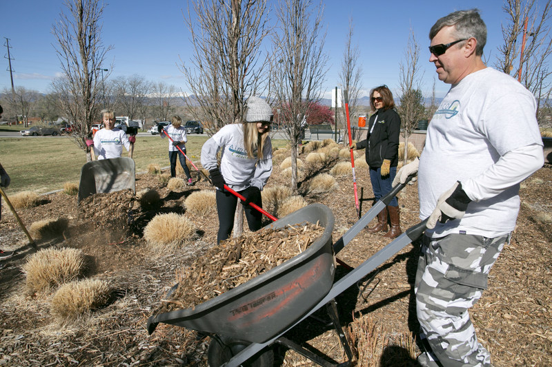 Apartment Investment and Management Company team members maintain a park in partnership with the Denver Parks and Recreation Department as part of the Aimco Cares National Community Service Week.