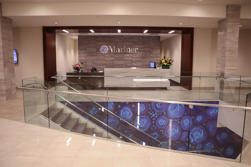 Reception desk at Mariner's new state-of-the-art headquarters, showing some of the innovative wall art incorporated into the facility.