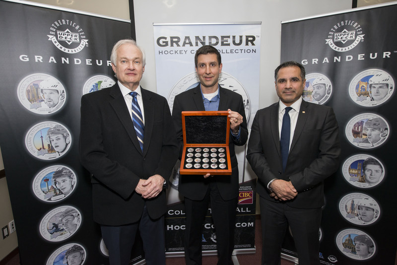 From left, Don Fehr, Executive Director of the National Hockey League Players' Association, Jason Masherah, President of Upper Deck, and Kam Dhadwar, Executive Director, Alternate and Retail Solutions Group, CIBC, pose for a picture at the Upper Deck Grandeur Hockey Coin Collection Launch Event at the Hockey Hall of Fame on Tuesday, April 4, 2017, in Toronto, Canada.