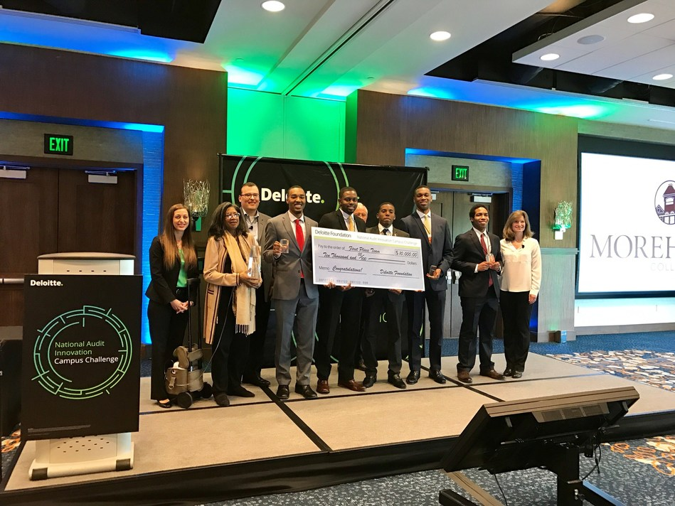 Deloitte Audit Innovation Campus Challenge winning team from Morehouse College accepting their first place prize with leaders in Deloitte's Audit practice and Deloitte Foundation