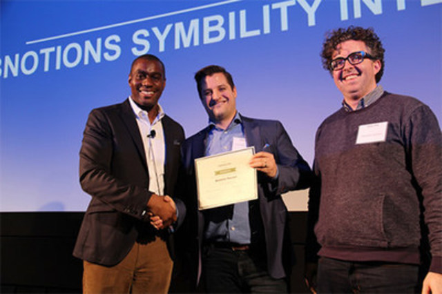 Michael Eubanks, LCBO& IT SVP and CIO,& congratulates Symbility Intersect CEO Paul Crowe (centre) and Product Manager Chris Hirst for winning& the first-ever IT Partner Award at the 2017 LCBO Partner Summit.& The award recognizes a tech partner that collaborates effectively and efficiently with the LCBO to help achieve IT business goals. (CNW Group/Symbility Solutions Inc.)