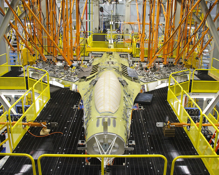 An F-16 undergoes durability testing in Lockheed Martin's Full Scale Durability Test facility in Fort Worth, Texas. (Lockheed Martin).