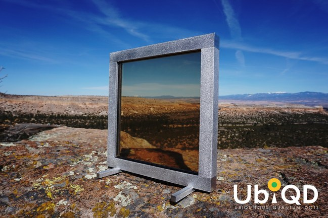 Prototype electricity-producing quantum dot window developed by UbiQD, one square foot in size, sits on a rock outcropping near the company's headquarters in Los Alamos, New Mexico.