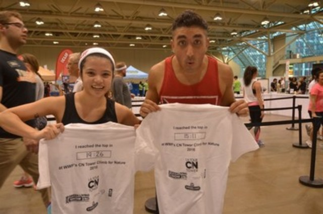 Climbers at WWF's 2016 CN Tower Climb show off their climb times. (CNW Group/WWF-Canada)