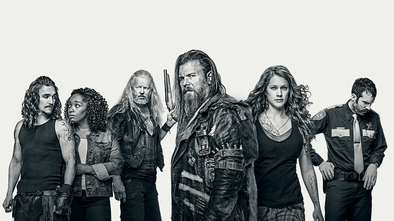 "(L-R) Kyle Gallner as Hasil, Christina Jackson as Sally-Ann, David Morse as Big Foster, Ryan Hurst as Lil Foster, Gillian Alexy as G'Winveer, and Thomas M. Wright as Sheriff Houghton in WGN America's ""Outsiders."""