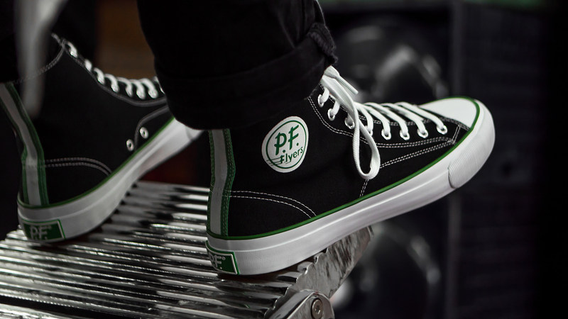 PF Flyers heritage meets New Balance performance technology in the newly redesigned All American. Based on one of PF Flyers' best sellers from the 1960's, the All American features vintage detailing and honors a tradition rooted in comfort. Original PF Flyers featured the celebrated 'Magic Wedge' insert, one of the sneaker industry's first innovations in comfort technology. Today, the All American features New Balance Fresh Foam insoles - a pioneering comfort platform.