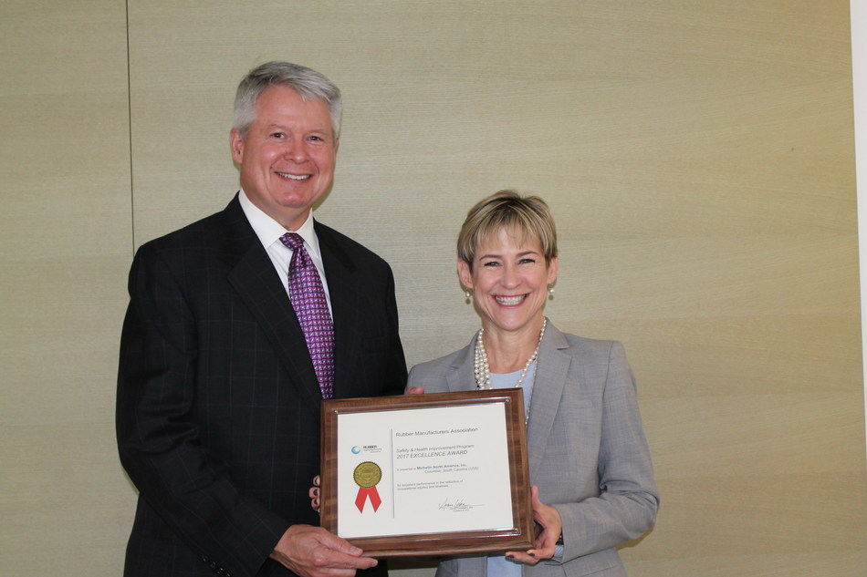 Pete Selleck, Chairman and President of Michelin North America, accepts RMA SHIP Awards from Anne Forristall Luke, President and CEO of the Rubber Manufacturers Association