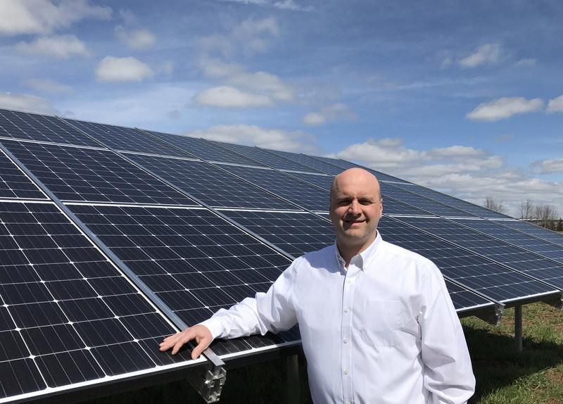 Ron Godshall, COO with Godshall's 4000th Solar Module
