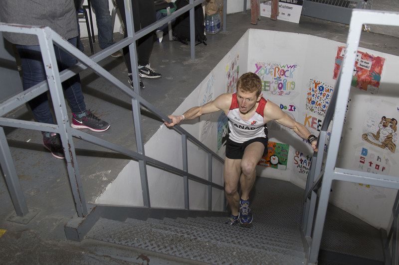 Shaun Stephens-Whale, 27, of Robert's Creek, B.C., crosses the finish line of WWF-Canada's CN Tower Climb for Nature on Sunday April 9, 2017. His time of 9 minutes and 54.9 seconds set a new record for WWF's annual climb. Credit: James Carpenter/WWF-Canada (CNW Group/WWF-Canada)