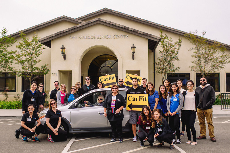 """In honor of April as Occupational Therapy Month, the University of St. Augustine for Health Sciences (USAHS) hosted a CarFit event, in collaboration with the Occupational Therapy Association of California (OTAC) and the San Marcos Senior Center. The event aimed to help senior drivers find a better """"fit"""" with their cars for comfort and safety."""