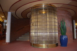 "Wright-designed ""bird cage"" elevator."