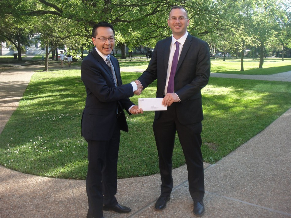 Jeff Chaapel, General Manager of OMNOVA Oil & Gas, presents $50,000 grant to Dr. Michael Wong, Rice University's Chemical and Biomolecular Engineering Department Chair.