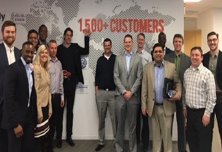 ObserveIT CEO Mike McKee (pointing to new 1,500+ customer sign) celebrates Q1 2017 success with Customer Advisory Board and executive team members at the company's headquarters in Boston.