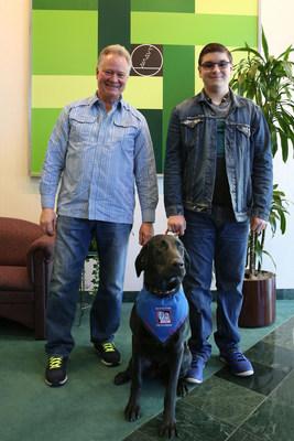 "Rick Korte (l.), HEIDENHAIN CORPORATION CEO, with Johnathon Wojciechowski and ""Pickles""."
