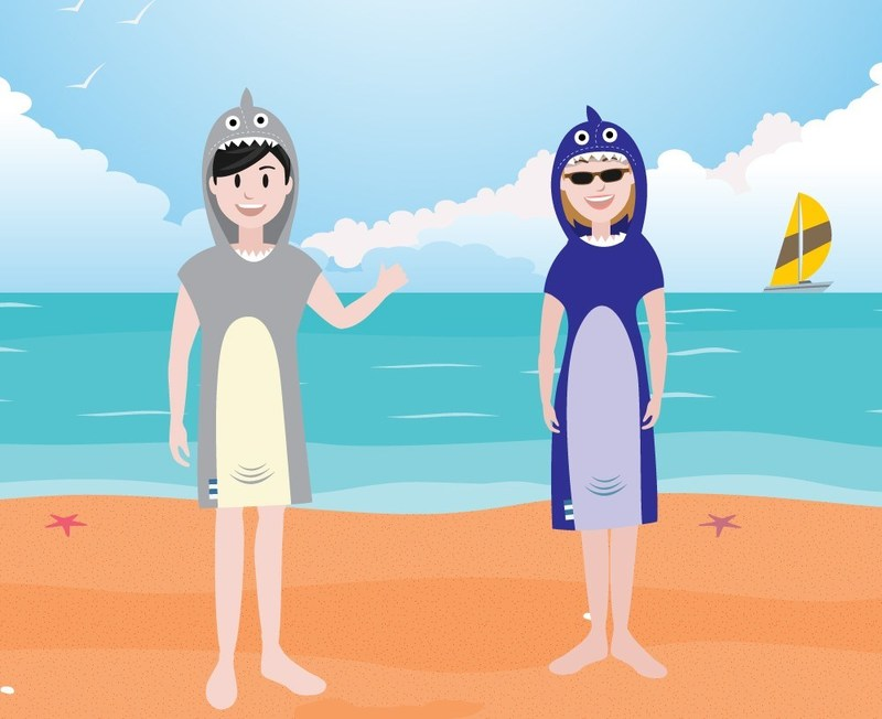 Cartoon image of people wearing the shark poncho towels