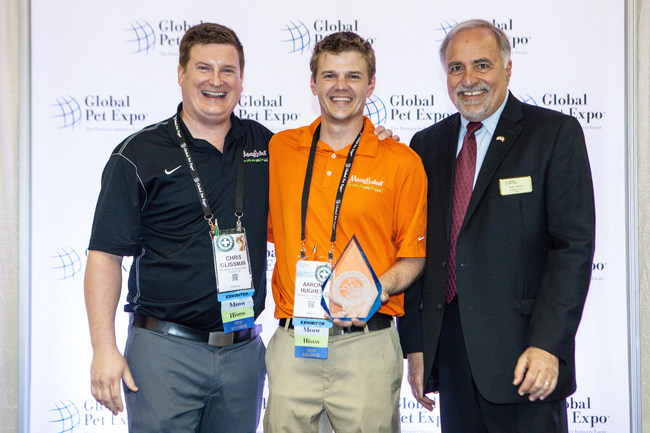 Meowijuana Founders Chris Glissman and Aaron Hughes accepting the Best-in-Show Award for their Point-of-Purchase Display from the President and CEO of the APPA - Bob Vetere.