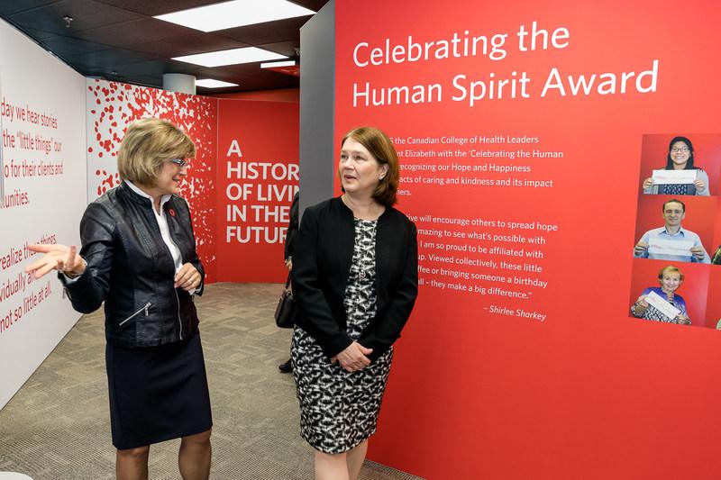 Saint Elizabeth CEO Shirlee Sharkey takes Minister Philpott on a tour of the organization's innovative showcase space. (photo: Vito Amati) (CNW Group/Saint Elizabeth Health Care)