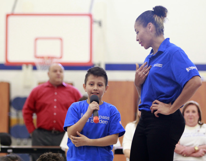 Student Jose Juarez asks a question as WNBA Legend Allison Feaster stands by at Victor Fields Elementary School in McAllen, Texas. BBVA Compass and WNBA Cares partnered to promote financial literacy at the school.(NOTE TO USER: User expressly acknowledges and agrees that, by downloading and/or using this Photograph, user is consenting to the terms & conditions of the  Getty Images License Agreement. Mandatory Copyright Notice: Copyright 2017 NBAE (Photo by Nathan Lambrecht/NBAE via Getty Images)